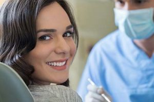 woman smiling in dentist chair, cosmetic dentistry conroe tx