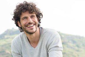 man smiling outside, general dentistry conroe tx