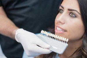 woman looking at veneer options, dental veneers tx