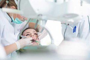 patient getting dental exam