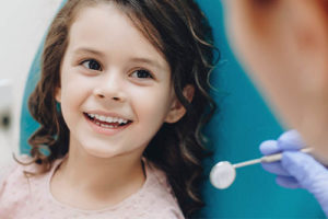 girl receiving pediatric dentistry services