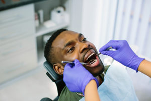 man learning about specialty dentistry services