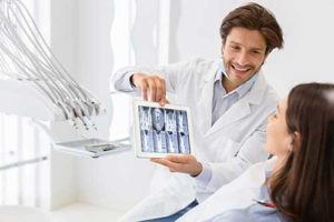 a dentist discusses orthodontics with his patient